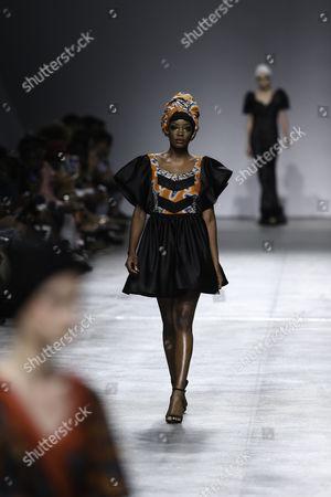 Stock Image of A model displays a creation by fashion designer Nadir Tati from Angola during her runway show at Lisbon Fashion Week, at Carlos Lopes Pavillion in Lisbon, Portugal, 08 October 2017.