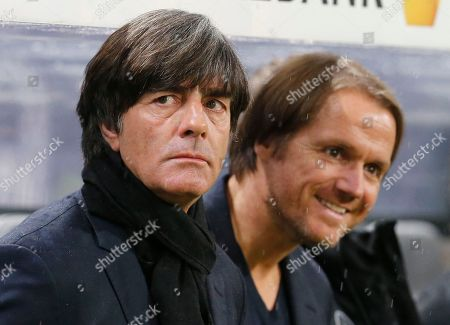 Germany head coach Joachim Loew, left, and his assistant Thomas Schneider wait for the beginning of the 2018 World Cup qualifying Group C soccer match between Germany and Azerbaijan in Kaiserslautern, Germany