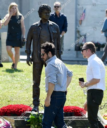 Stock Image of J.J. Abrams, Simon Pegg. Filmmaker J.J. Abrams, center, and actor Simon Pegg attend a life celebration and statue unveiling for the late actor Anton Yelchin at Hollywood Forever Cemetery, in Los Angeles. Yelchin died in June 2016 at the age of 27