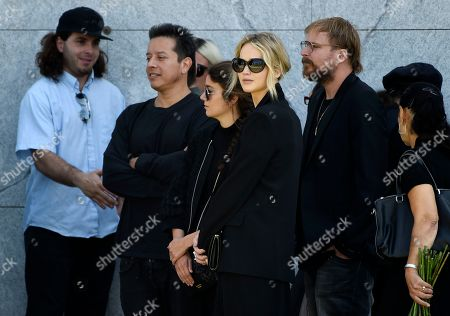 Actress Jennifer Lawrence, center, arrives at a life celebration and statue unveiling for the late actor Anton Yelchin at Hollywood Forever Cemetery, in Los Angeles. Yelchin died in June 2016 at the age of 27
