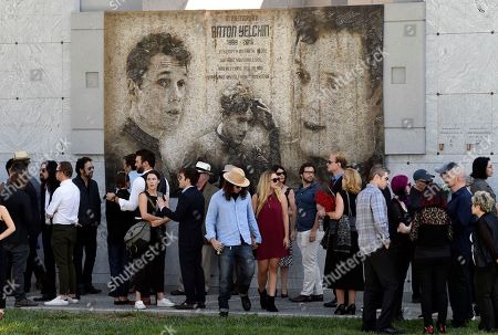 "Guests gather beneath a mural of the late actor Anton Yelchin created by fans at a ""Star Trek"" convention, during a life celebration and statue unveiling for Yelchin at Hollywood Forever Cemetery, in Los Angeles"