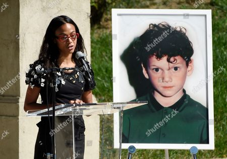 "Actress Zoe Saldana addresses guests at a life celebration and statue unveiling for the late actor Anton Yelchin at Hollywood Forever Cemetery, in Los Angeles. Yelchin died in June 2016 at the age of 27. Saldana and Yelchin were fellow cast members in the ""Star Trek"" film franchise"