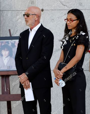 Actress Zoe Saldana, right, stands beside the late actor Anton Yelchin's father Viktor, left, at a life celebration and statue unveiling for Yelchin at Hollywood Forever Cemetery, in Los Angeles. Yelchin died in June 2016 at the age of 27