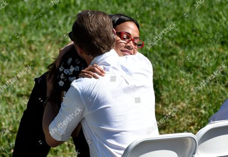 "Zoe Saldana, Simon Pegg. Actress Zoe Saldana hugs fellow ""Star Trek"" cast member Simon Pegg at a life celebration and statue unveiling for the late actor and ""Star Trek"" cast member Anton Yelchin at Hollywood Forever Cemetery, in Los Angeles. Yelchin died in June 2016 at the age of 27"