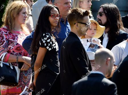 "Actress Zoe Saldana, left, looks on during a life celebration and statue unveiling for the late actor Anton Yelchin at Hollywood Forever Cemetery, in Los Angeles. Yelchin died in June 2016 at the age of 27. Saldana and Yelchin were fellow cast members in the ""Star Trek"" film franchise"