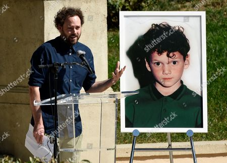"Director Drake Doremus speaks at a life celebration and statue unveiling for the late actor Anton Yelchin at Hollywood Forever Cemetery, in Los Angeles. Doremus directed Yelchin in his 2011 film ""Like Crazy."" Yelchin died in June 2016 at the age of 27"