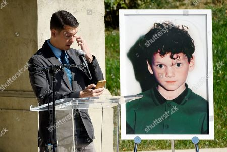 "Director Jeremy Saulnier wipes away a tear as he speaks at a life celebration and statue unveiling for the late actor Anton Yelchin at Hollywood Forever Cemetery, in Los Angeles. Saulnier directed Yelchin in his 2015 film ""Green Room."" Yelchin died in June 2016 at the age of 27"