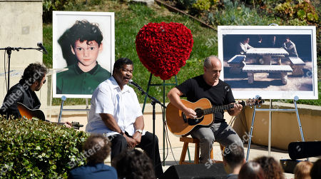 "Jerry Lawson, Fred Parnes. Singer Jerry Lawson is joined by actor/director Fred Parnes, right, as he performs the song ""Lay Down"" at a life celebration and statue unveiling for the late actor Anton Yelchin at Hollywood Forever Cemetery, in Los Angeles. Yelchin died in June 2016 at the age of 27"