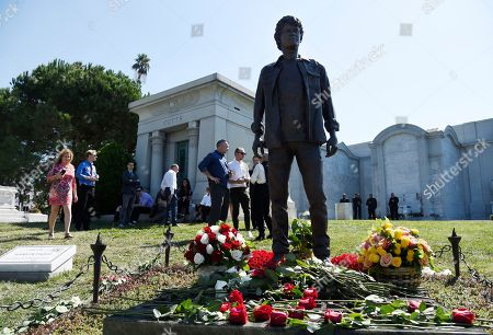 Guests gather around a statue of the late actor Anton Yelchin during a life celebration and statue unveiling for Yelchin at Hollywood Forever Cemetery, in Los Angeles. Yelchin died in June 2016 at the age of 27