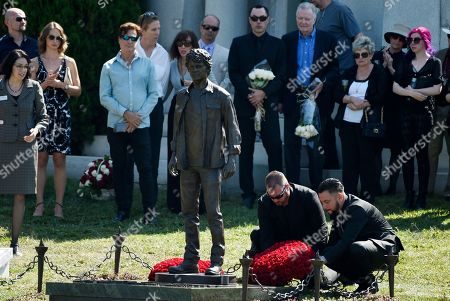 Flowers are laid down behind a statue of the late actor Anton Yelchin at a life celebration and statue unveiling for Yelchin at Hollywood Forever Cemetery, in Los Angeles. Yelchin died in June 2016 at the age of 27