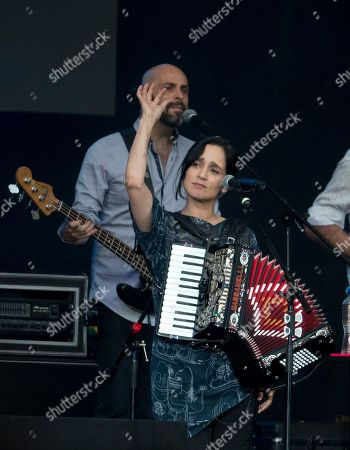 """Mexican Julieta Venegas performs during a concert in Mexico City's main square, the Zocalo, . The free concert, """"Estamos Unidos Mexicanos,"""" was held for those who were impacted by the Sept. 19, earthquake"""