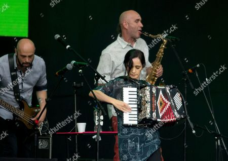"""Stock Image of Mexican Julieta Venegas performs during a concert in Mexico City's main square, the Zocalo, . The free concert, """"Estamos Unidos Mexicanos,"""" was held for those who were impacted by the Sept. 19, earthquake"""