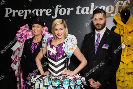 American singer and former Pussycat Dolls member Ashley Roberts, center, poses for photographers, along with crew members Emma Hardy and Andrew Cooper, in a dress entirely made from safety cards . As part of Air New Zeland #RunwaytoLA campaign, the airline will give away a pair of tickets from London to Los Angeles every 15 minutes on at London Waterloo Station