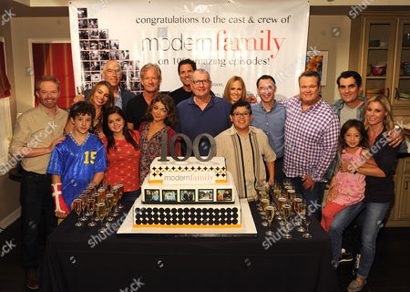 "Modern Family"" cast, co-creators and producers celebrate production of the 100th episode of the groundbreaking and Emmy award-winning comedy series, from left back row, cast members Jesse Tyler Ferguson and Sofia Vergara, TCFTV chairman Gary Newman, co-creators Chris Lloyd and Steve Levitan, cast member Ed O'Neill, TCFTV chairman Dana Walden, president ABC Entertainment Group Paul Lee, cast members Eric Stone Street, Ty Burrell, Julie Bowen and Aubrey Anderson-Emmons, from left front row, cast members Nolan Gould, Ariel Winter, Sarah Hyland and Rico Rodriguez,, in Los Angeles, Calif"