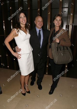 "From left, director Lori Silverbush, restaurateur Tom Colicchio and Lauren Bush attend an after party for a screening of ""A Place at the Table"" presented by Bank of America and The Cinema Society, in New York"