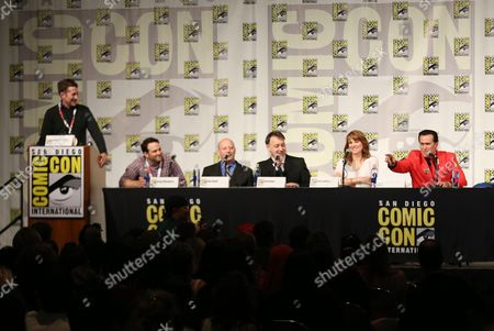 "From left, moderator Scott Aukerman, show runner Craig DiGregorio, Ivan Raimi, Sam Raimi, Lucy Lawless, and Bruce Campbell are seen onstage during the panel for the STARZ original series ""Ash vs Evil Dead"" at San Diego Comic-Con on in San Diego"
