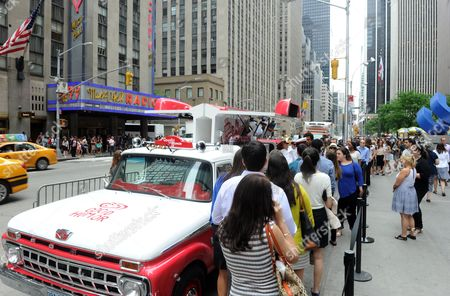 Crowds enjoy free frozen treats at the unveiling of The Good Humor Truck during the launch of the Good Humor Welcome to Joyhood campaign, in New York. Follow GoodHumor on Twitter as the Joy Squad travels to other cities this summer.â