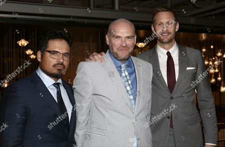 From left, actor Michael Pena, director John Michael McDonagh and actor Alexander Skarsgard pose for photographers upon arrival at the Premiere of the film War On Everyone, in central London