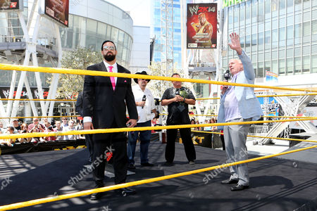 """IMAGE DISTRIBUTED FOR 2K - (Right to Left) WWE Hall of Famers Ric Flair, Jerry """"The King"""" Lawler and Jim Ross address the crowd as WWE Superstar Damien Sandow looks on at the WWE 2K14 Roster Reveal, on in Los Angeles. 2K announced the roster for the 30 Years of WrestleMania Mode, which will be featured in WWE 2K14 when it releases on Oct. 29 in North America and Nov. 1 internationally"""