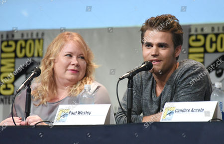 "Julie Plec, left, and Paul Wesley attend ""The Vampire Diaries"" panel on day 4 of Comic-Con International, in San Diego. Looking on at left is Julie Plec"