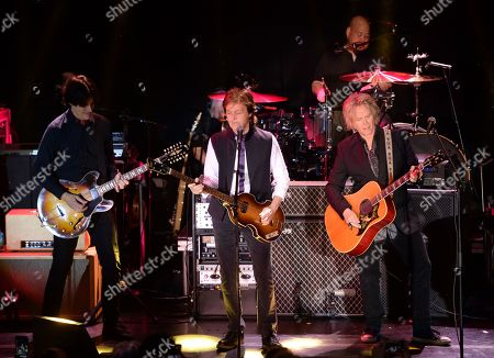 Paul McCartney, center, and his band, including Rusty Anderson, left, and Brian Ray, perform a secret Valentine's Day concert at Irving Plaza, in New York
