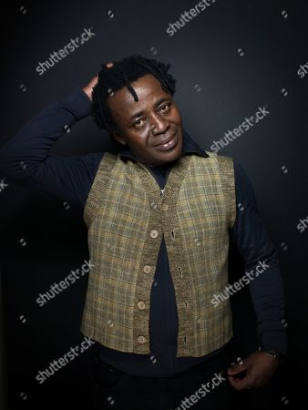 """Director John Akomfrah from the film """"The Stuart Hall Project"""" poses for a portrait during the 2013 Sundance Film Festival at the Fender Music Lodge on in Park City, Utah"""