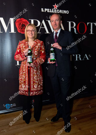 """Stock Photo of Nicoletta Mantovani Pavarotti and CEO and President S.Pellegrino Stefano Agostini attend a preview of the exhibition """"AMO PAVAROTTI"""" in celebration of a new partnership between S.Pellegrino and the Luciano Pavarotti Foundation at 82MERCER, on in New York"""