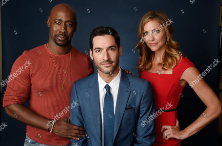 "DB Woodside, left, Tom Ellis, center, and Tricia Helfer, cast members in the Fox series ""Lucifer,"" pose together during the 2016 Television Critics Association Summer Press Tour at the Beverly Hilton, in Beverly Hills, Calif"