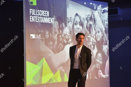 Stock Photo of Fullscreen Media Founder and CEO George Strompolos presents at the Fullscreen Media NewFront event at the Altman Building, in New York