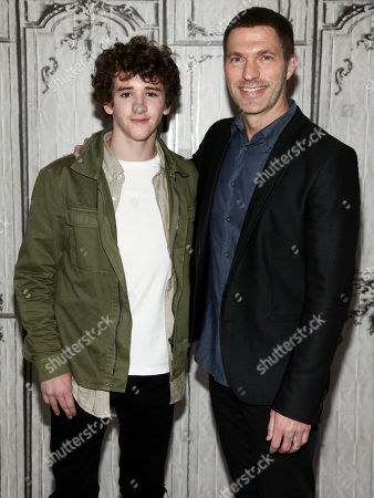 Actor Art Parkinson, left, and President and CEO of LAIKA Travis Knight, right, participate in AOL's BUILD Speaker Series to discuss the film Kubo and the Two Strings at AOL Studios, in New York