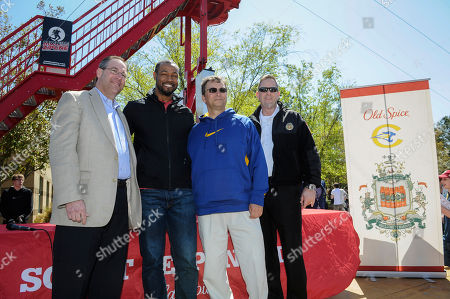 """As part of the national Old Spice Scent Responsibly school tour, the world-famous """"Old Spice Guy"""" Isaiah Mustafa, second from left, kicks off Chattahoochee High School's annual Springfest with Mayor Mike Bodker, left, principal Tim Duncan, and Johns Creek Fire Dept. Fire Chief Jeff Hogan, right, on in Johns Creek, Ga"""