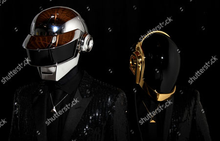 """Thomas Bangalter, left, and Guy-Manuel de Homem-Christo, from the music group, Daft Punk, pose for a portrait in Los Angeles. The electronic duo's new studio album, """"Random Access Memories"""" releases in the US on May 21"""