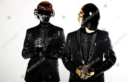 """Thomas Bangalter, left, and Guy-Manuel de Homem-Christo, from the music group, Daft Punk, pose for a portrait in Los Angeles. The electronic duo's new studio album, """"Random Access Memories"""" releases in the US on May 21, 2013"""