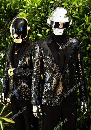 """Thomas Bangalter, right, and Guy-Manuel de Homem-Christo, from the music group, Daft Punk, pose for a portrait in Los Angeles. The electronic duo's new studio album, """"Random Access Memories"""" releases in the US on May 21, 2013"""