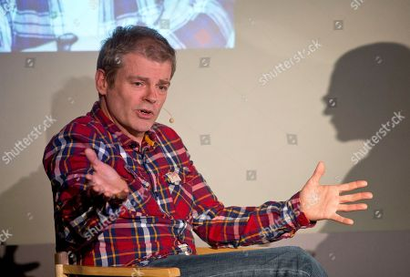 Author Mark Haddon discusses his latest novel 'The Red House' during a 'Meet the Author' session at the Apple Store, in central London, . His novel, The Curious Incident of the Dog in the Night-time, sold over 3 million copies, won 17 literary prizes, including the Whitbread Award, and has recently been adapted into a hit West End play