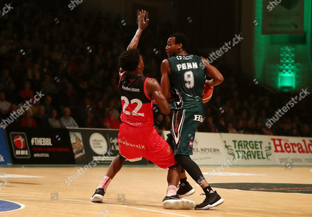 Stock Picture of Brandon Penn of Plymouth Raiders under pressure from Eric Robertson of Leicester Riders