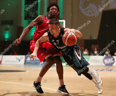 Nick Tomsick of Plymouth Raiders gets around Eric Robertson of Leicester Riders