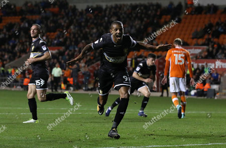 Jermaine Beckford of Bury celebrates scoring a goal