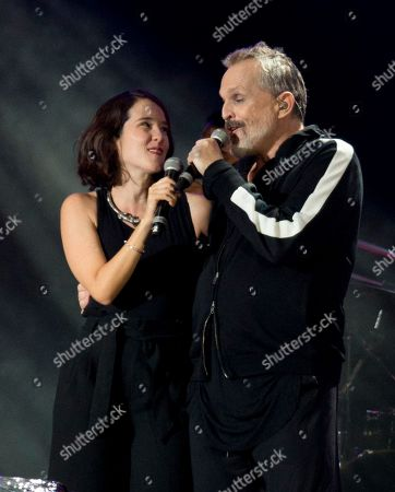 "Ximena Sarinana, Miguel Bose. Mexican singer-songwriter Ximena Sarinana, left, and Spanish musician Miguel Bose, perform during the ""Estamos Unidos Mexicanos"" or Mexicans United concert, in Mexico City's main square, the Zocalo, . The free concert was held to help relief efforts in Mexico in the aftermath of the Sept. 7 and 19, earthquakes. More than 150,000 people attended"