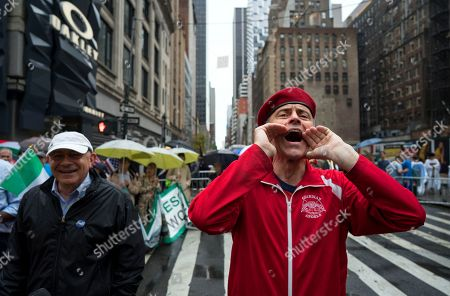 Curtis Sliwa, right, founder of the Guardian Angels, yells toward New York Mayor Bill de Blasio during the annual Columbus Day Parade in New York