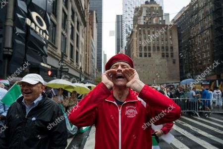 Curtis Sliwa founder of the Guardian Angels, yells toward New York Mayor Bill de Blasio during the annual Columbus Day Parade in New York