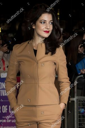 Actress Esther Garrel poses for photographers upon arrival at the premiere of the film 'Call Me By Your Name' during the London Film Festival in London