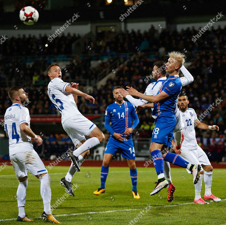 Iceland's Hordur Bjorgvin Magnusson, right, goes for header with Kosovo's Amir Rrahmani second right, during the World Cup Group I qualifying soccer match between Iceland and Kosovo in Reykjavik, Iceland