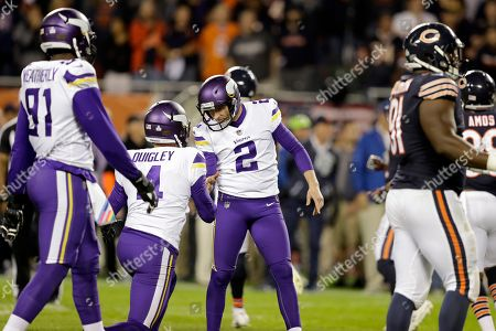 Kai Forbath, Ryan Quigley. Minnesota Vikings kicker Kai Forbath (2) celebrates a game winning field goad with Ryan Quigley (4) during the second half of an NFL football game, in Chicago. The Vikings won 20-17