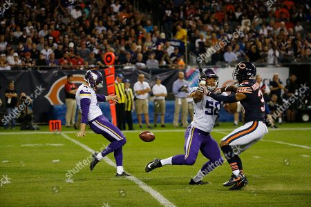 Minnesota Vikings' Ryan Quigley (4) punts against the Chicago Bears during the first half of an NFL football game, in Chicago