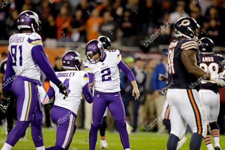 Kai Forbath, Ryan Quigley. Minnesota Vikings kicker Kai Forbath (2) celebrates athe game-winning field goal with Ryan Quigley (4) during the second half of an NFL football game, in Chicago. The Vikings won 20-17