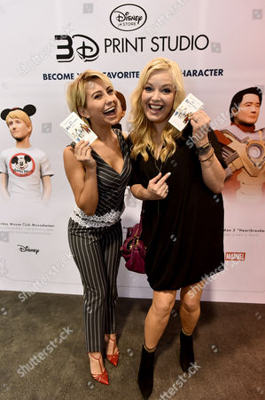 "Chelsea Kane and Melissa Peterman from ABC Family's ""Baby Daddy"" pose at the Disney Store 3D Print Studio at D23 Expo on in Anaheim, Calif"