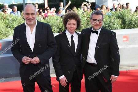 From left, producers Guillermo Arriaga, Michel Franco, and Rodolfo Cova pose for photographers during the red carpet for the film, Desde Alla (From afar) at the 72nd edition of the Venice Film Festival in Venice, Italy, . The 72nd edition of the festival runs until Sept. 12