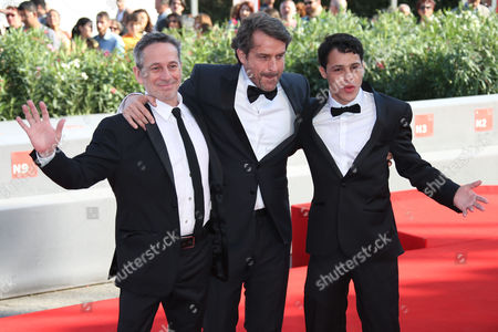 From left, Alfredo Castro, director Lorenzo Vigas and Luis Silva pose for photographers during the red carpet for the film, Desde Alla (From afar) at the 72nd edition of the Venice Film Festival in Venice, Italy, . The 72nd edition of the festival runs until Sept. 12