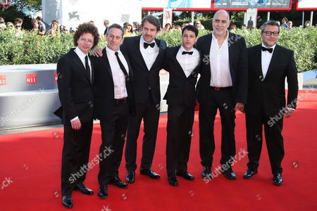 From left, Michel Franco, Alfredo Castro, director Lorenzo Vigas, Luis Silva, Guillermo Arriaga and Rodolfo Cova, pose for photographers during the red carpet for the film, Desde Alla (From afar) at the 72nd edition of the Venice Film Festival in Venice, Italy, . The 72nd edition of the festival runs until Sept. 12